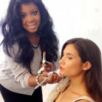 L'Oréal Paris Makeup Artist Brandy Gomez-Duplessis doing makeup on model for ENEWS hair segment with Johnny Lavoy.